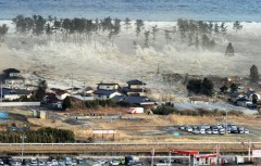 tsunami3-sweeps-in-to-engulf-a-residential-area-after-a-powerful-earthquake-in-natori.jpg
